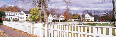White fence and homes Royalty Free Stock Photography