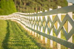 White fence leading up to a big red barn Royalty Free Stock Photo