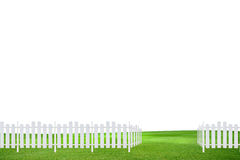White Fence in Meadow Royalty Free Stock Image