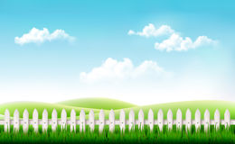 White fence in nature summer background. Royalty Free Stock Photo