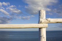White fence overlooking atlantic ocean. Shot in PEI, Canada Stock Photo