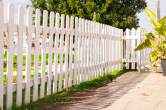 White fence in perspective Stock Images
