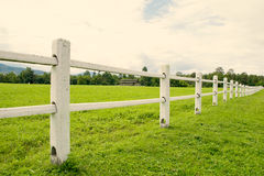 White fence perspective and green grass in Farm (vintage filter style) Stock Photography