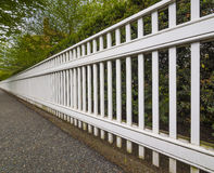 White fence. In perspective view Royalty Free Stock Image