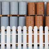 White fence that separates the area of the storage tanks. Stock Images