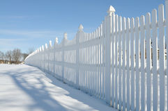 White fence on the snow Stock Images