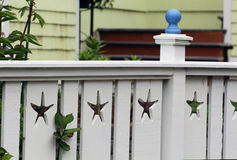 White fence with starfish cut outs and arbor at coast. White low fence with starfish cut outs and and Arbor, very stylish and cute Royalty Free Stock Image