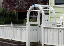 White fence with starfish cut outs and arbor at coast. White low fence with starfish cut outs and and Arbor, very stylish and cute Stock Photos