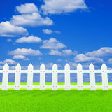 White fence on a summer lawn Royalty Free Stock Images
