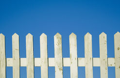 White fence with blue sky. Stock Photo