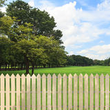 White fences garden Royalty Free Stock Photo