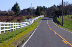 White fences & road. Stock Photography