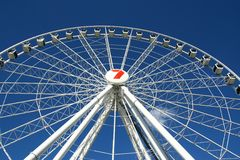 White Ferris Wheel agains a Clear Blue Sky Royalty Free Stock Photography