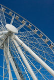 White Ferris Wheel agains a Clear Blue Sky Royalty Free Stock Photos