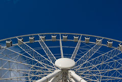White Ferris Wheel agains a Clear Blue Sky Stock Photo