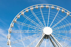 White ferris wheel against blue background Royalty Free Stock Photo