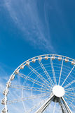 White ferris wheel against blue background Royalty Free Stock Image
