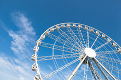 White ferris wheel against blue background Stock Photography