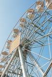White ferris wheel against blue sky background Stock Image