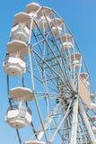 White ferris wheel against blue sky Stock Images