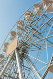 White ferris wheel against blue sky Stock Photos
