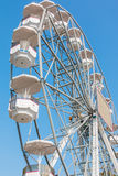 White ferris wheel against blue sky background Royalty Free Stock Image
