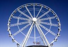 White Ferris wheel with blue background. Amazing ferris wheel near the sea in Bari, Italy royalty free stock photo