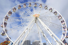 White ferris wheel with cloudy blue sky taken at Darling Harbour in Sydney Australia on 6 July 2016 Stock Photo