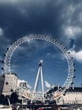 White Ferris Wheel Near White Buildings royalty free stock photography