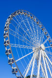 White ferris wheel over blue sky. Brisbane, Australia - September 24, 2016: White ferris wheel on the background of blue sky during daytime Stock Photos