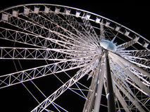 White Ferris Wheel over dark night sky Stock Photography