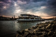 White Ferry Boat by Rocky Shore Royalty Free Stock Image