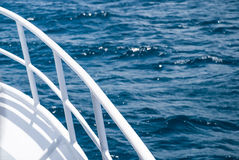 White Ferry Railing Against Blue Ocean Royalty Free Stock Photography