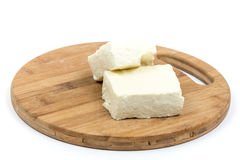 White feta cheese slices on the wooden board Royalty Free Stock Images