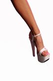 White fetish stiletto. Female leg in high fetish style stiletto heels. image is isolated royalty free stock photography