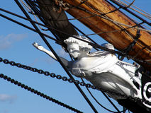 White figurehead on tallship. White figurehead on old tallship coming into harbor stock photography