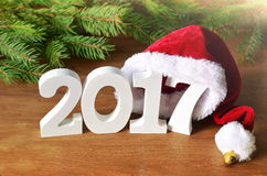 White figures 2017. Santa hat, spruce branch and Christmas decorations Royalty Free Stock Images