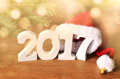 White figures 2017. Santa hat, spruce branch and Christmas decorations Royalty Free Stock Image