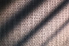 White fine mesh texture. abstract background. Light and shadow. stock photo