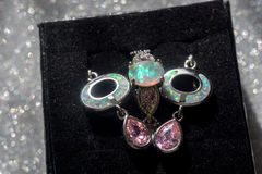 White Fire Opal Jewelry Set. Fashion earrings and ring with white fire opal and pink topaz stock images