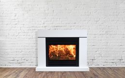 White Fireplace in bright empty living room interior of house.  stock photos