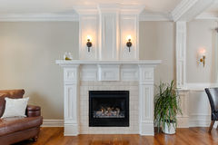 White fireplace in luxury home. White fireplace with stone inlay in luxury home Stock Photo