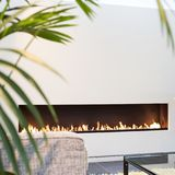 White fireplace modern design with green plant. In white room Stock Photo