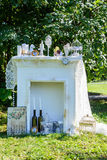 White fireplace with various accessories mounted outdoors Royalty Free Stock Images