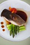 White fish with asparagus Stock Image