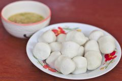 White Fish Ball in Plate with Seafood Sauce stock image