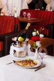 White fish in a bucket of champagne restaurant interior tables eating food Royalty Free Stock Photography