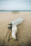 White fish buoy on sandy beach over crab pot background. Stock Photography