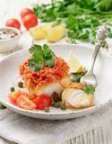 White fish cod, Pollock, nototenia, hake, braised with onions, carrots and tomatoes. Vegetable marinade. Delicious hot or cold snacks for foodies. Selective royalty free stock photo