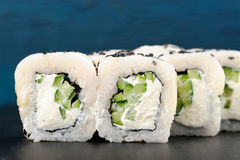 White fish, cream cheese, black sesame seeds and cucumber sushi Royalty Free Stock Images